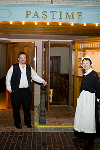 docents in costume with hotel door